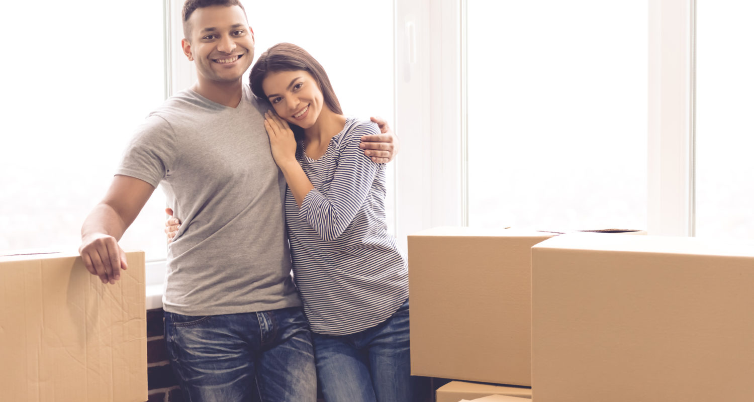 A couple standing in their move in ready home